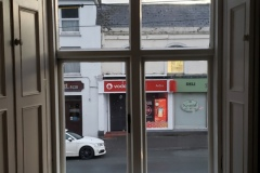 view out the drawing room window onto the main street